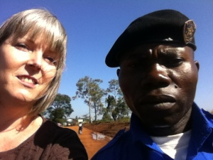 Deb and a police officer from Democratic Republic of the Congo